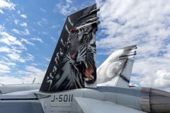 Tail of Swiss Air Force McDonnell Douglas F/A-18C Hornet multirole fighter aircraft from Staffel 11 11 Squadron. Payerne, Switzerland - September 1, 2014: Tail royalty free stock image