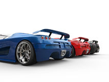 Tail view of the sportscars Stock Photos