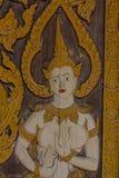 Tailandés talle en estilo de la puerta del tablero de madera, en el templo en el Norther Fotos de archivo libres de regalías