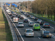 Tailback during peak hour on freeway, Netherlands Stock Photos