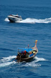 Tailboat and speedboat Royalty Free Stock Photo