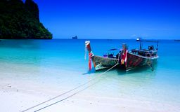 Tailboats by the shore at Hong Island, Krabi Thail Royalty Free Stock Photography