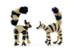 Tailed lemur toys. Couple Crochet  straw  ring-tailed lemur toys Royalty Free Stock Photo