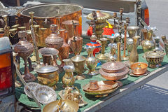 Tailgate sale. Antique brass bronze and silver objects for sale at tailgate Stock Image