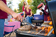 Tailgating: Bratwurst or Sausage On The Grill At Tailgate Party Royalty Free Stock Photos