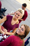 Tailgating: Cute Co-Eds Smile At Camera During Party Stock Photo