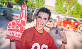 Tailgating: Excited Fan Wearing Foam Finger And Cheering royalty free stock photo