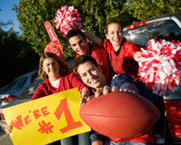 Tailgating: Excited Fans Cheering For Team And Holding Sign stock image