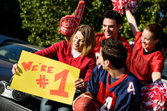 Tailgating: Excited Fans Look At Friend's Sign royalty free stock photos