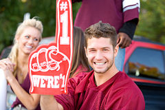 Tailgating: Football Fan Holds Up Number One Foam Finger Stock Photos