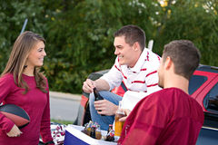 Tailgating: Friends Having Drinks And Talking About Game Royalty Free Stock Images
