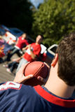 Tailgating: Friends Playing Ball Before Game. Group of friends at a football tailgating party outside Royalty Free Stock Photo