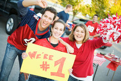 Tailgating: Friends Rally Together For Favorite Team While Holding Sign royalty free stock image