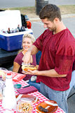 Tailgating: Guy Getting Food At Tailgate Party Royalty Free Stock Image
