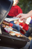 Tailgating: Man Grilling Sausages And Other Food For Tailgate Pa Stock Images