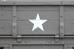 Tailgating. Military cargo truck tailgate featuring a white star against olive drab Stock Photography