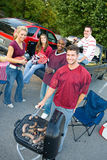 Tailgating: Smiling Group Waits For Tailgate Food To Cook stock photo