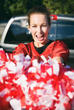 Tailgating: Woman Holding Poms Cheers For Team Royalty Free Stock Photo