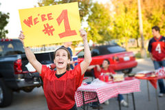 Tailgating: Woman Holds Up Number One Sign For Team Royalty Free Stock Image