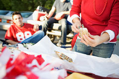 Tailgating: Woman Putting Shrimp On Skewer Stock Photography