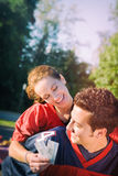 Tailgating: Woman Rides Piggyback While Holding Game Tickets Stock Photos