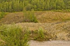 Tailingshögar på guldgruvaliten vik Royaltyfria Bilder