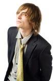 Taille vers le haut de verticale de jeune homme sur gris-clair Photos libres de droits