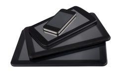 3 tailles différentes des tables et du smartphone noirs Photographie stock libre de droits