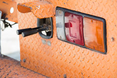 Taillight and Excavator control handlebars. Stock Images
