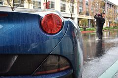 Taillight on sports car in rain Stock Photo