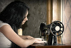 Tailor. Young caucasian female tailor at work royalty free stock photo