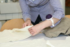 Tailor altering clothes needle and thread Royalty Free Stock Photos