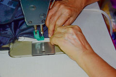 Tailor is changing the zip 1. Tailor is changing new the zip of cloth Bag royalty free stock photos