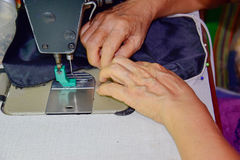 Tailor is changing the zip 2. Tailor is changing new the zip of cloth Bag royalty free stock photo