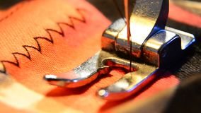 Tailor Closeup of sewing machine working part with colorful cloth. stock footage