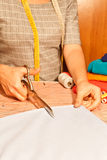 Tailor cutting fabric Royalty Free Stock Photo