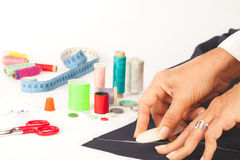 Tailor designing clothes. Sewing tools in background Royalty Free Stock Images