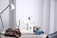 Tailor desk with modern machine. Tailor desk with modern sewing machine royalty free stock photos