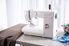 Tailor desk with sewing machine. Tailor desk with modern sewing machine royalty free stock image