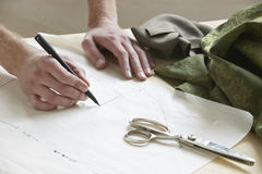 Tailor Drawing Pattern On Paper At Table Royalty Free Stock Images