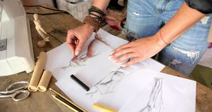 Tailor drawing sketches stock video