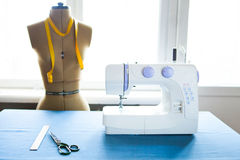 Tailor dummy with measuring tapes in fashion studio Royalty Free Stock Photo