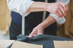 Tailor Hand stitching Cloth in Atelier Royalty Free Stock Photography