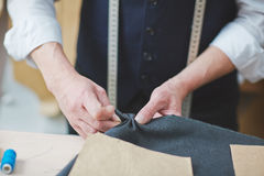 Tailor Hand stitching Garments in Atelier Royalty Free Stock Images