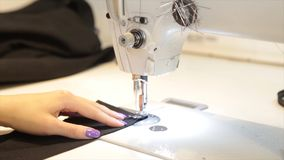 Tailor.Hands notch tailor tailor`s scissors cloth. Female tailor stitching material at workplace. Preparing fabric for stock image