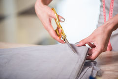 The tailor hands working on new clothing. Tailor hands working on new clothing Royalty Free Stock Photography
