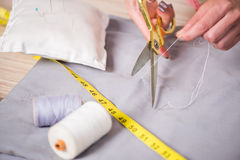 The tailor hands working on new clothing. Tailor hands working on new clothing Royalty Free Stock Images