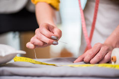 The tailor hands working on new clothing. Tailor hands working on new clothing Royalty Free Stock Photo