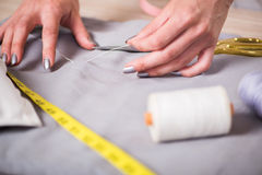 The tailor hands working on new clothing Stock Photos
