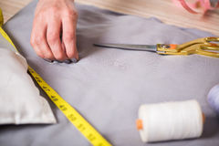 The tailor hands working on new clothing. Tailor hands working on new clothing Stock Photography